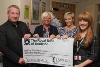 Staff raise £1,500 for Bolton Hospice and £300 for Urban Outreach