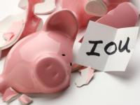 piggy bank with IOU message